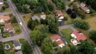 AERIAL: Quiet luxury suburban town with spacious exquisite houses in lush nature video