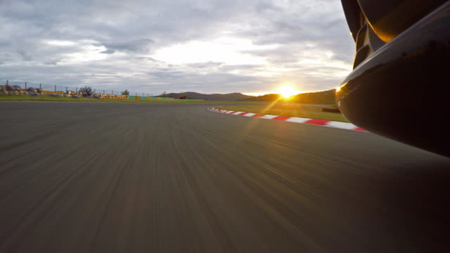 Race car driving towards the sunset video