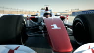 Race car on desert circuit - close-up front video