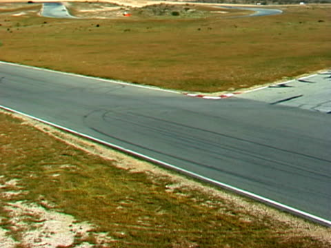 Race Cars Go By on Track video
