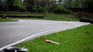 Race Go-kart in a curve rear view video