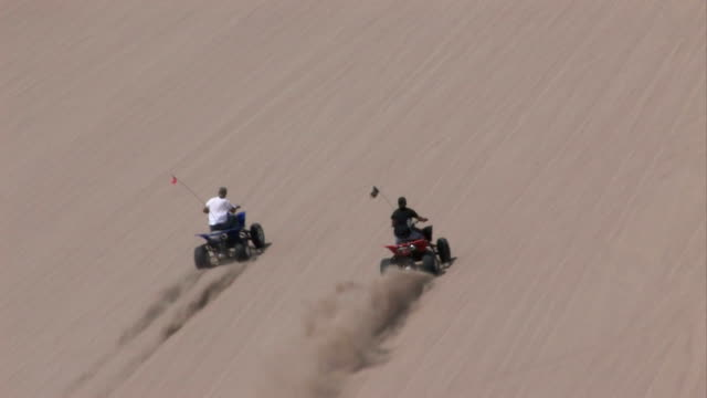 Race to top of sand dune ATV video