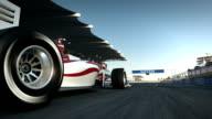 racecar speeding past camera - side view video