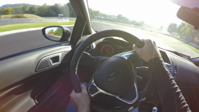 Racing at a race track, professional sports car drivers point of view video