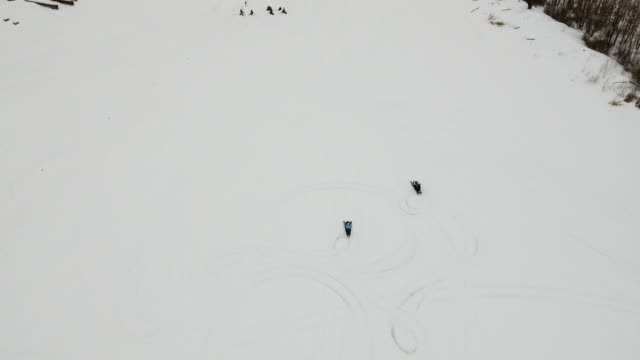 Racing on a snowmobile video
