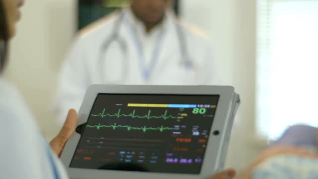 rack focus from portable monitor to patient video