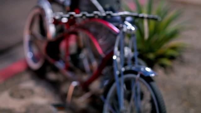 Rack Focus of a Parked Red Custom Bike. video