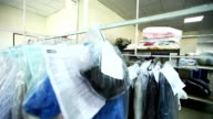 Rack with clean clothes at dry cleaners video