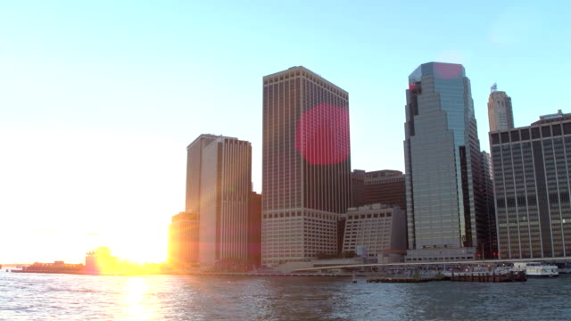 LOW ANGLE: Radiant views of the New York Lower Manhattan skyline as the sun sets video