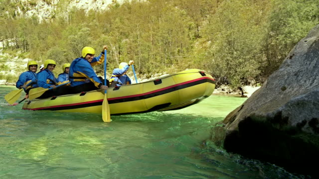 HD: Rafters Running The Raft On A Rock video