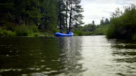 Rafts float smoothly down a river video