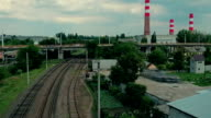 Railroad going through industrial district video