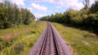 Railroad. Railway tracks from moving train. Travelling background video