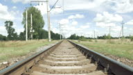Railroad track in perspective on blue sky video