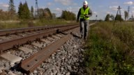 Railroad worker take pictures of the rails video
