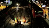 Railroad workers make repairs rails video
