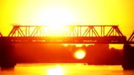 railway bridge at sunset video