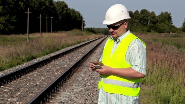 Railway Engineer to count money on railway video