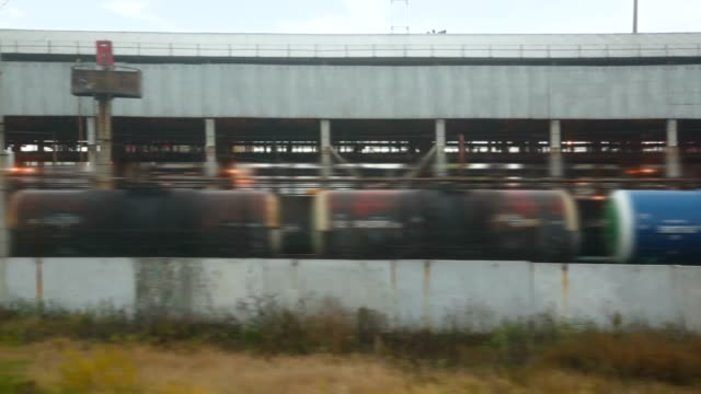 Railway station with freight train of tank waggons video