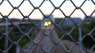 Railway track behind fence video