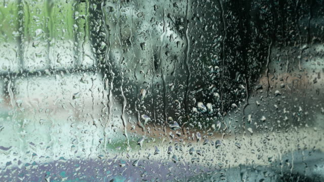 Rain drop at the window in rainy day video