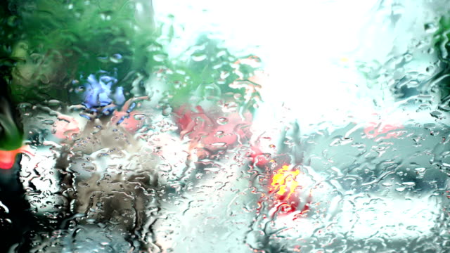 Rain drop on windshield while traffic jam in bad weather day video