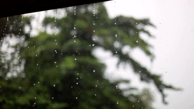 Rain drops falling from roof's eave during rain storm in Koh Samui. Thailand. 1920x1080 video