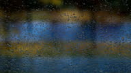 Rain drops on the home window glass with lightning flashes video