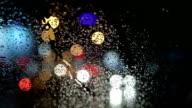 Rain drops on windshield at night video