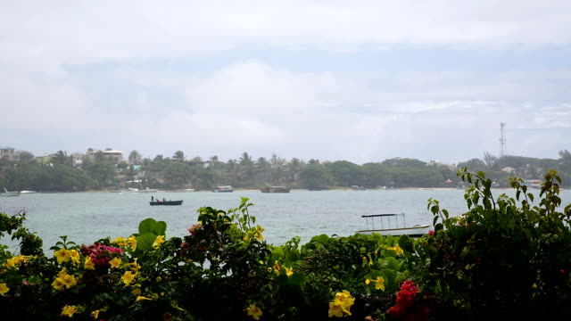 Rain in mauritius and boats in background video