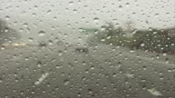 Rain mist on windshield while driving down highway video