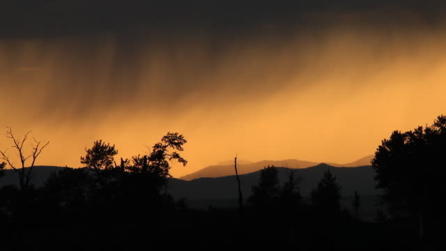 Rain showers over mountain scenic at dusk video