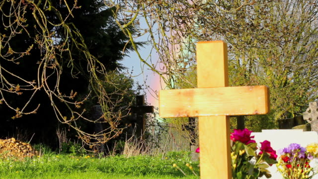 Rainbow and cross in cemetry video