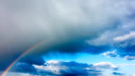 Rainbow in the sky after the rain, time-lapse video