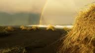 Rainbow over the horizon on Stokksnes beach video