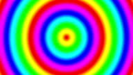 Rainbow spectral gradient rings moving quickly out, seamless loop video