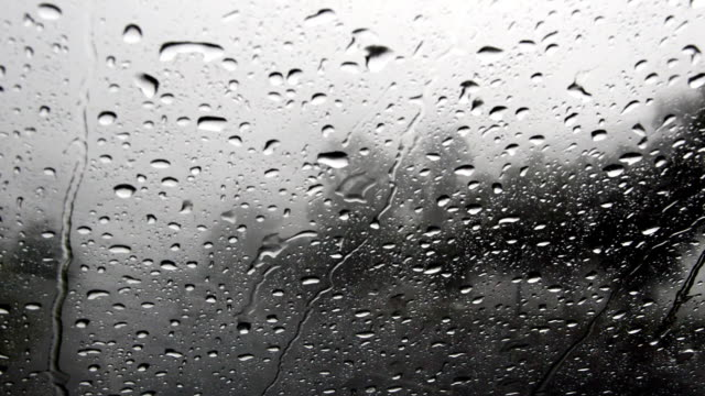 Raindrops on car windshield video