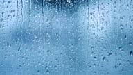 Raindrops on the window. Blue tone video