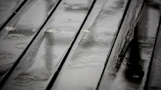 Rainwater on a wooden floor at terrace video