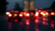 Rainy highway. Defocused brake lights. video
