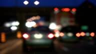 Rainy highway. Defocused traffic lights. video
