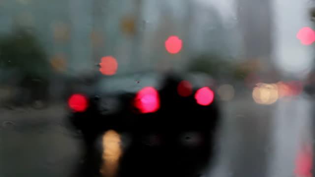 Rainy window with braking traffic. Good audio. video