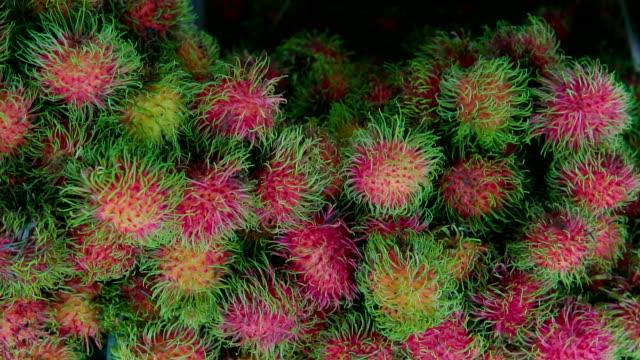 Rambutan tropical fruit at local market video