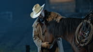 SLO MO DS Rancher doing groundwork with horse at night video