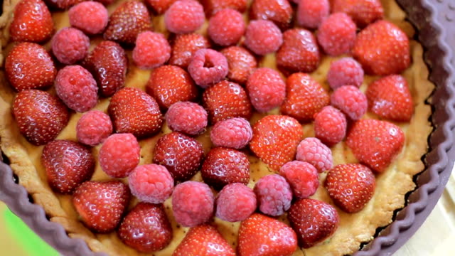 Raspberries falling on the fruit tart video