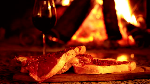 Raw Beef Steaks In Front Of Fireplace video