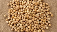 Raw chickpeas on a burlap rotating. Seamless loopable. Prores FullHD video