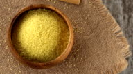 Raw couscous on burlap rotating. Seamless loopable video