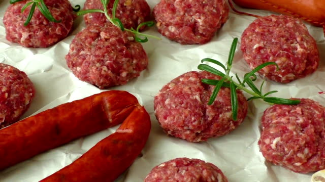 Raw minced hamburger meat with herb and spice video