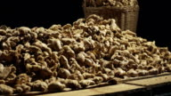 Raw Organic Ginger root over black background video